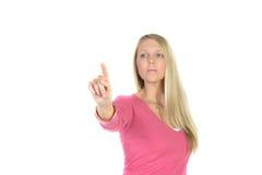 Blonde Frau vor Sichttouch Screen Lizenzfreies Stockfoto