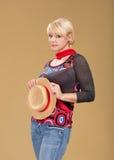 Blonde Frauen- und Strohmütze Stockfotos