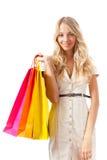 Blonde Frauenholding-Einkaufenbeutel Lizenzfreies Stockbild