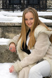 Blonde frecked girl in fur coat Stock Photos