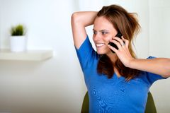 Blonde Friendly Young Woman Conversing On Phone Royalty Free Stock Photography