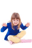 Blonde funny scaring little girl sitting Royalty Free Stock Photography