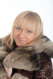 Blonde in a fur coat Royalty Free Stock Photos