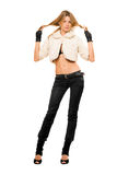 Blonde in a fur coat and black jeans Royalty Free Stock Photo