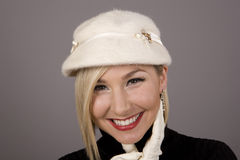 Blonde in Fur Hat Laughing Hand on Chin stock photo
