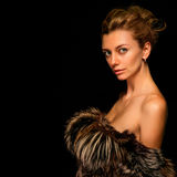 Blonde in fur vest Royalty Free Stock Photography