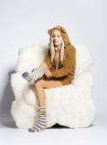 Blonde on furry arm-chair Royalty Free Stock Photos
