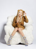 Blonde on furry arm-chair Stock Image