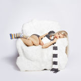 Blonde on furry arm-chair Royalty Free Stock Photo
