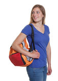 Blonde german student with bag looking back Royalty Free Stock Images