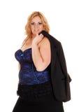 Blonde Geschäftsfrau der natürlichen Größe gehoben über Schulter Stockbild
