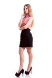 Blonde Geschäftsfrau, die weg auf weißem Hintergrund lokalisiert schaut Stockfotos