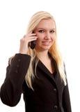 Blonde Geschäftsfrau ersucht um das Telefon Stockbilder