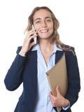 Blonde Geschäftsfrau mit blauen Augen und Blazer am Telefon Stockfotos
