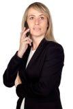 Blonde Geschäftsfrau mit einem Mobile Lizenzfreies Stockfoto