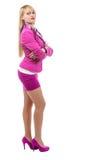 Blonde Geschäftsfrau mit rosa Klage Lizenzfreie Stockfotos