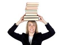 Blonde Geschäftsfrau mit vielen Büchern Lizenzfreie Stockbilder