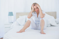 Blonde getting headache on the morning Royalty Free Stock Photos