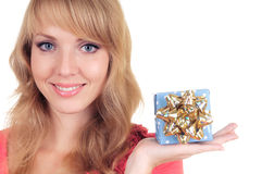 Blonde and a gift box Royalty Free Stock Photos