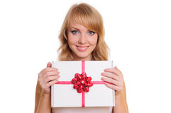 Blonde and a gift box Royalty Free Stock Images