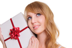 Blonde and a gift box Stock Photos