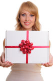 Blonde and a gift box Stock Images