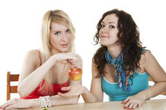 Blonde gir lgive her friend an apple Stock Photography