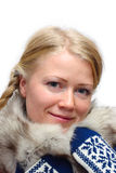 Blonde girl. In fur collar and knitted mittens Stock Photography