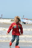 Blonde girl. A blonde girl on stormy beach  e Royalty Free Stock Photo