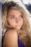 Blonde girl. Curly blond girl looking up Royalty Free Stock Photo
