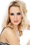 Blonde girl. Portrait of young beautiful blond girl with trendy makeup royalty free stock image