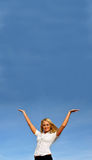 Blonde girl against the sky. Space for text Royalty Free Stock Photo