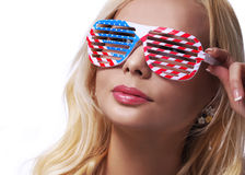 Blonde Girl with American Flags Sunglasses. Royalty Free Stock Images