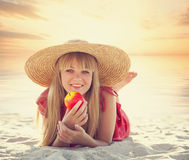 Blonde girl with apple Royalty Free Stock Photos