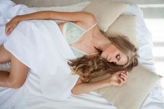 Blonde girl asleep in the bedroom dreams holiday morning. 1 Stock Photos