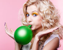 Blonde girl with balloon Royalty Free Stock Photography