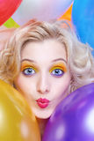 Blonde girl with balloons. Portrait of beautiful blonde girl with balloons celebrating birthday Royalty Free Stock Images
