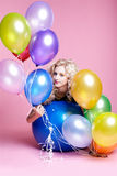 Blonde girl with balloons Stock Photo