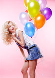 Blonde girl with balloons Stock Photos