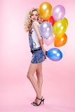 Blonde girl with balloons Royalty Free Stock Photo