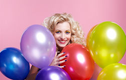 Blonde girl with balloons Royalty Free Stock Images