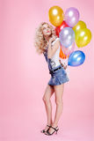 Blonde girl with balloons Royalty Free Stock Photography