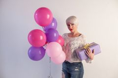Blonde girl with balloons and gifts for holiday. 1 Stock Images