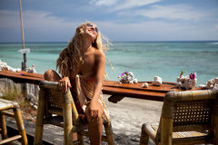 Blonde girl in the bar. On the beach of Bali stock photo