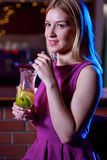 Blonde girl in the bar Royalty Free Stock Image