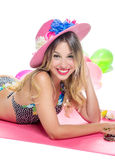 Blonde girl in a bathing suit. Pretty young blonde girl in a bathing suit smiling and hat on white background Stock Image