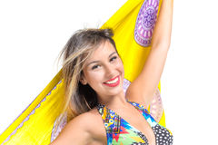 Blonde girl in a bathing suit. Pretty young blonde girl in  bathing suit smiling on white background Royalty Free Stock Image