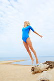 Blonde girl on beach Stock Image