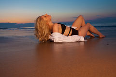 Blonde girl on the beach Royalty Free Stock Images