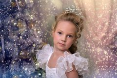 Blonde girl with a beautiful hairdo in a smart dress. With candles in her hands Royalty Free Stock Image